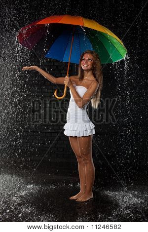 .young Woman With Multi-coloured Umbrella.