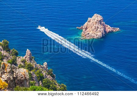 Fast Motor Boat Goes Near Rocks Of Capo Rosso