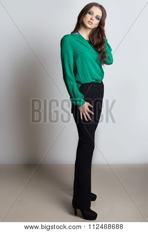 Fashionable beautiful sexy elegant woman with bright evening make-up in shades of green with long ha