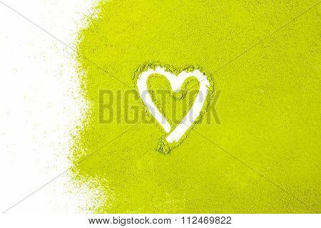 Green Powder Forming Heart Shape Surface Close Up