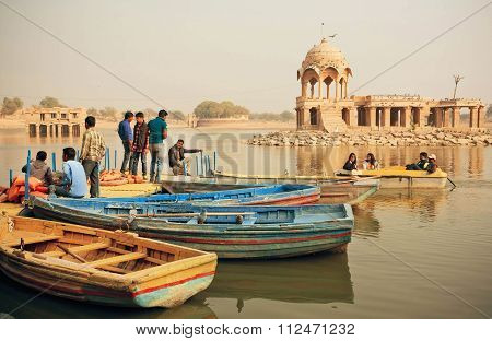 Young People And Women Meeting On Riverboats Dock With Ancient Indian Towers In India