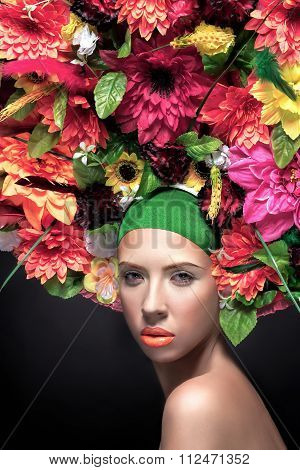 Beautiful Young Woman Portrait  With Flowers Hairstyle And Summer Orange Flowers. Fashion Makeup