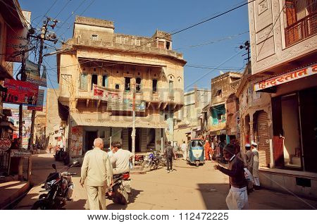 Street With Walking People And Historical Houses With Fresco And Carvings, Rajasthan.