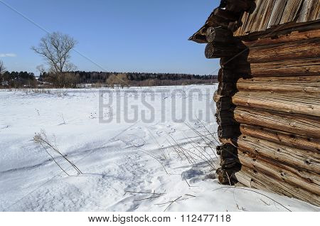 Corner Of Weathered Log Barn On The Village Outskirts, Winter Time