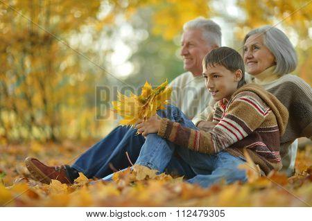 Happy grandparents with grandson
