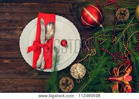 Christmas Plate And Silverware With Red Ribbon,  Toned Photo