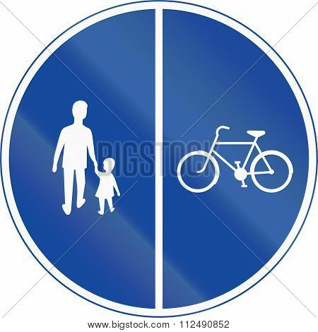 Road Sign Used In Sweden - Compulsory Track For Pedestrians, Cyclists And Moped Drivers. Dual Track