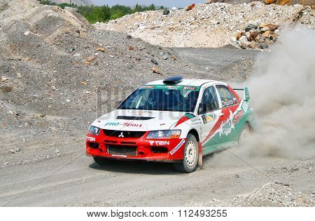 BAKAL, RUSSIA - AUGUST 13: Rally Southern Ural, Andrei Zhigunov's Mitsubishi Lancer Evolution IX WRC #2 on August 13,2010 in Bakal, Satka district, Chelyabinsk region, Russia.