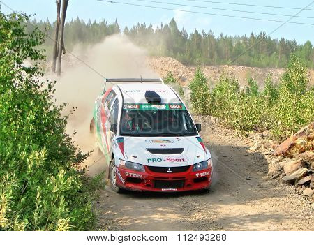 BAKAL, RUSSIA - AUGUST 13: Andrey Zhigunov's Mitsubishi Lancer Evo IX WRC No. 2 competes at the annual rally