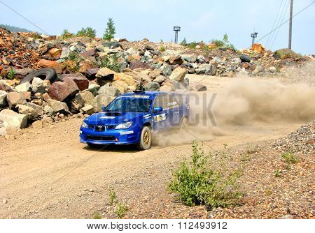 BAKAL, RUSSIA - AUGUST 13: Alexey Tserlyukevitch's Subaru Impreza WRX (No. 7) competes at the annual Rally Southern Ural on August 13, 2010 in Bakal, Satka district, Chelyabinsk region, Russia.