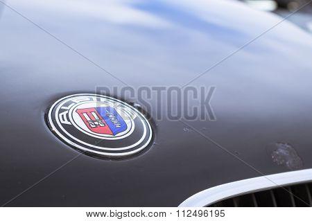 Logo Alpina. Old-car Bmw 5-series E34