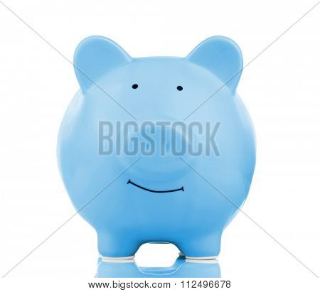 Blue ceramic piggy bank isolated on white