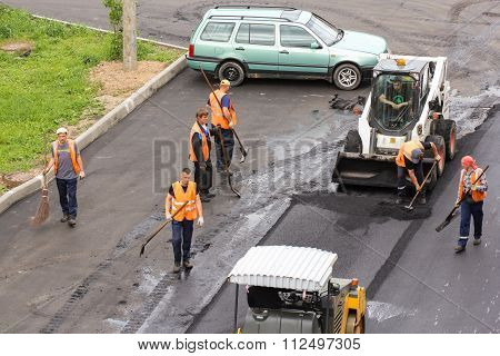 Working With A Tool For Road Works.