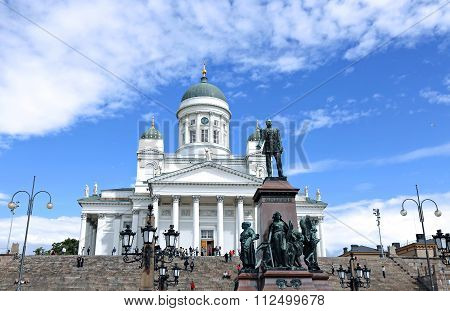 Cathedral Of St. Nicholas (cathedral Basilica) And Monument To Alexander Ii On The Senate Square In