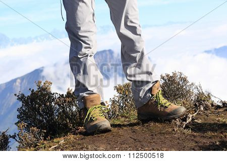 hiking legs enjoy the beautiful landscape on mountian peak