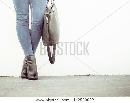 Woman In High Heels Shoes Holds Handbag