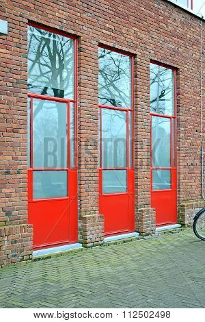 Red Doors On The Brick Wall, Building Industry