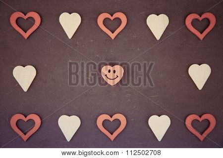 Heart Shapes Symbols And Smiling Emoticon Isolated On Black, Vintage Filter Applied
