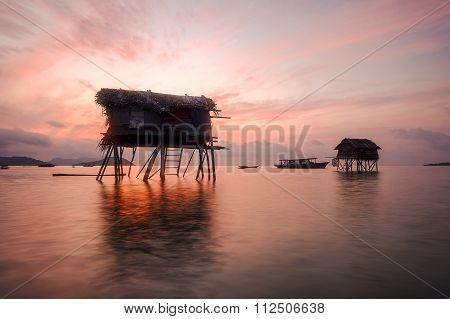 Beautiful Sunrise At Maiga Sipadan Island With Seagypsy House Located At Semporna, Sabah, Malaysia.