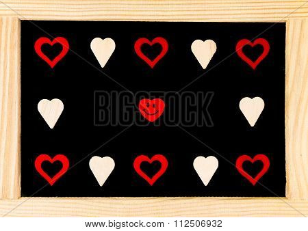 Wooden Frame Vintage Chalkboard With Red Heart Shape Symbols And Smiling Emoticon