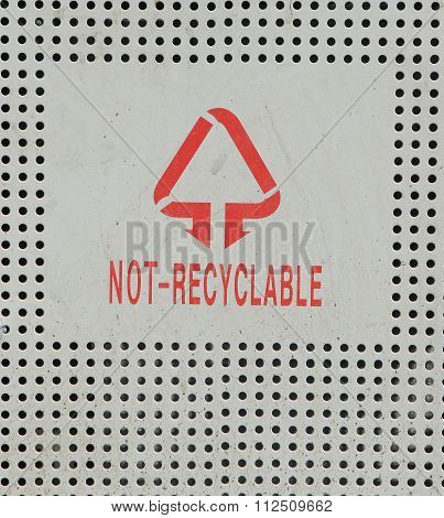 Recyclable and not recyclable sign on recycle bin