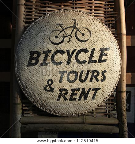 Close up of a sign for bicycle for rent or tours