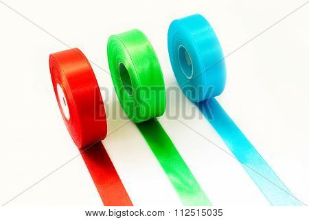 Red Green Blue ribbon Roll isolated on white background
