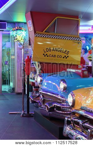 MOSCOW - JAN 21, 2015: Vintage cars in the interior American restaurant Beverly Hills Diner