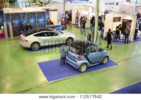MOSCOW - MAR 14, 2015: The Third International Exhibition MATE 2015. An electric Tesla Model S and Smart Fortwo Electric Drive in Exhibition Center Sokolniki in Moscow