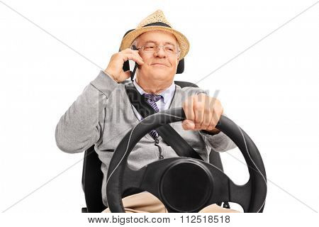 Senior man pretending to drive a car and talking on the cell phone isolated on white background