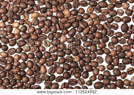 Dark Roasted Coffee Beans On White Background