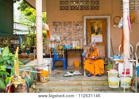 KOH CHANG - THAILAND - CIRCA DEC, 2015: Unidentified local monk. The island is part of marine national Park Mu Ko Chang. Koh Chang population of 5356 people living in 8 villages.