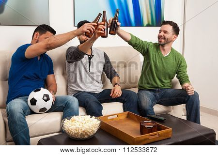 Soccer Fans Making A Toast With Beer