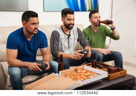 Male Friends Playing Videogames
