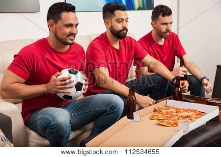 Friends Rooting For Their Soccer Team