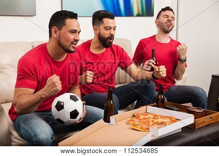 Male Soccer Fans Watching A Game