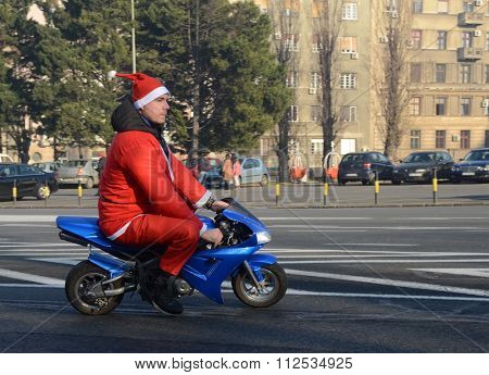 BELGRADE, SERBIA - DECEMBER 26: Undefined Santa delivering humanitarian aid in form of gifts to disabled children during annual Santa Claus Motorcycle Parade on 26 December 2015 in Belgrade, Serbia