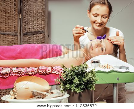 stock photo attractive lady getting spa treatment in salon, massage doctor smiling care