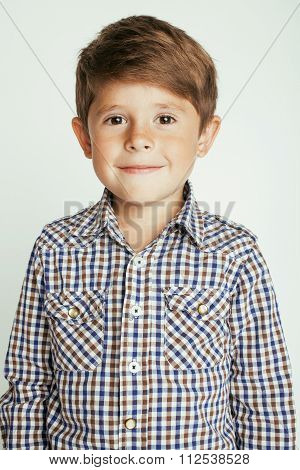 little cute boy on white background gesture smiling close up casual kid