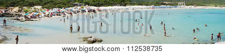 Costa Rei, Italy - August 25: Unidentified People In Beach Called Scoglio Di Peppino. Panoramic View