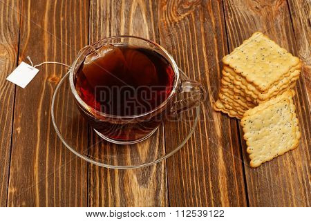 Cup Of Hot Tea And Cookies On Wooden Table