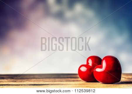 Two Hearts on a wooden board. Valentine's Day. Valentine's Greeting