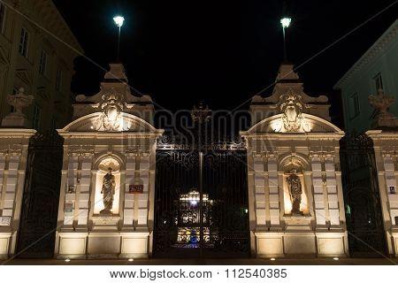 Warsaw University gates at night