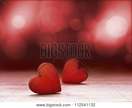Red Wooden Hearts Against Defocused Lights.