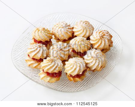 Jam sandwich cookies powdered with icing sugar