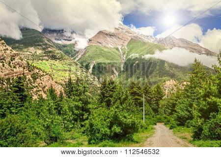 beautiful mountains landscape from rural road in cloudy day in Nepal, Annapurna trekking