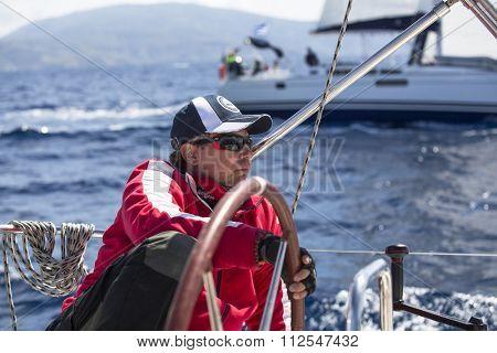 ANDROS - SYROS, GREECE - CIRCA APR, 2014: Sailors participate in sailing regatta 11th Ellada 2014 among Greek island group in the Aegean Sea, in Cyclades and Argo-Saronic Gulf.