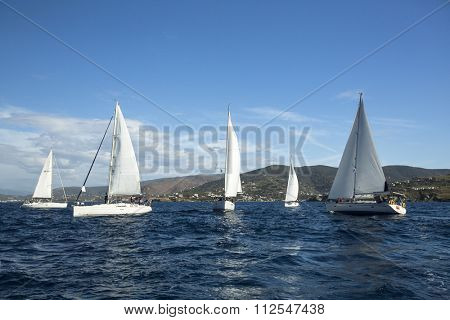ANDROS - SYROS, GREECE - CIRCA APR, 2014: sailboats participate in sailing regatta 11th Ellada 2014 among Greek island group in the Aegean Sea, in Cyclades and Argo-Saronic Gulf.