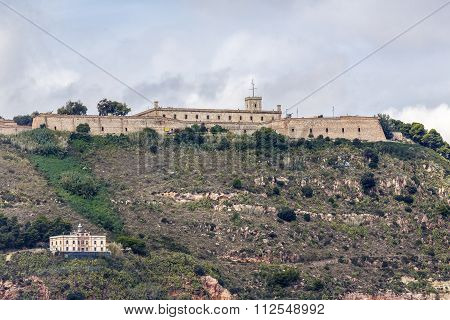View of Castillo de Montjuic and lighthouse on mountain Montjuic in Barcelona Spain