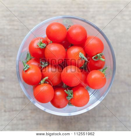 Fresh cherry tomato on wood table background